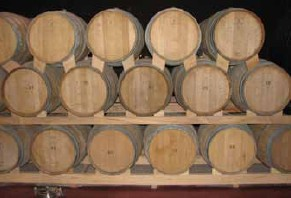 stacked oak barrels maturing red wine. Stacked Oak Barrels Maturing Red Wine C